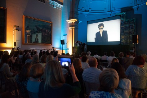 Yoko Ono makes a speech on video as she wins the Lifetime Achievement award at the Observer Ethical Awards 2015, held at the V&A Museum